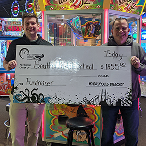 Two men holding up giant check