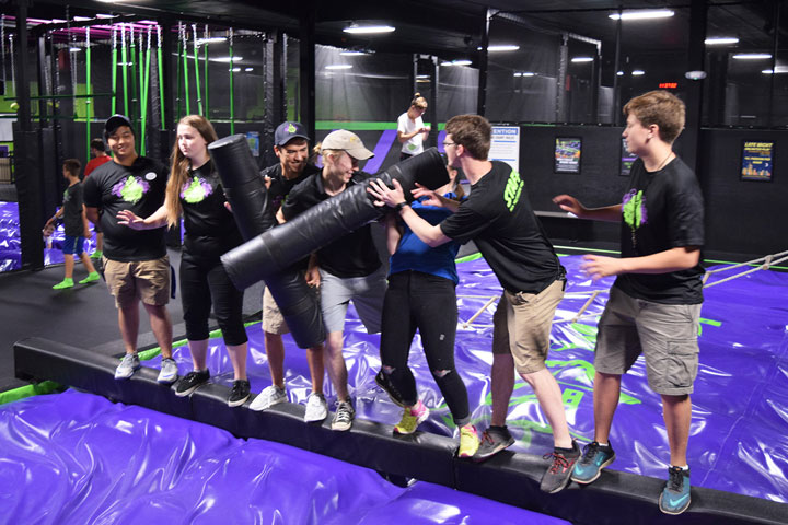 Action City Employees playing on the jousting beam