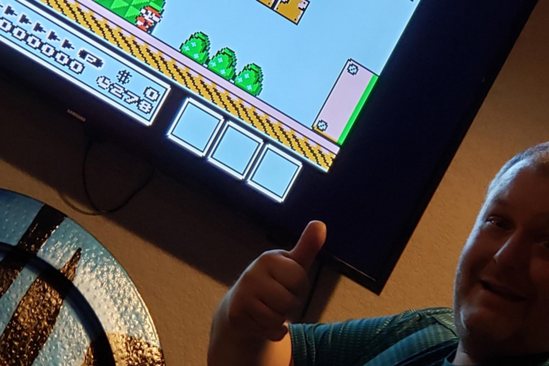 Man playing mario giving thumbs up.
