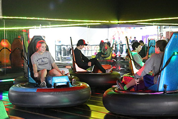 People driving bumper cars