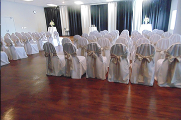 Theatre style wedding ceremony seating with white chair covers