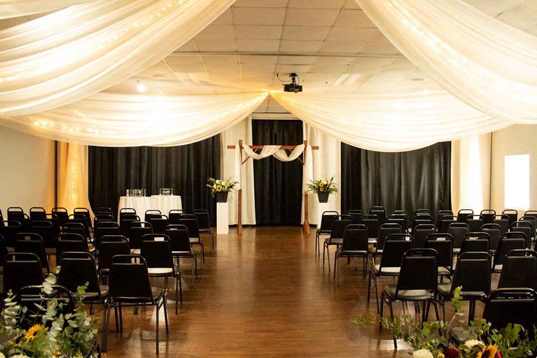 Metropolis Banquet hall with tulle draped and theatre seating for wedding.