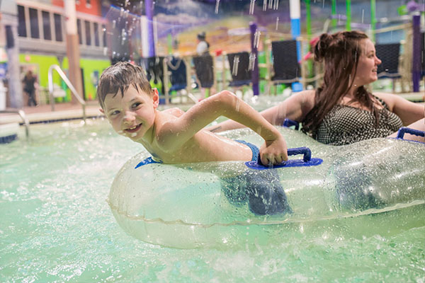 Young boy riding a tube in the Lazy River