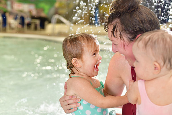 Little girl giggling at her mom in the water park.