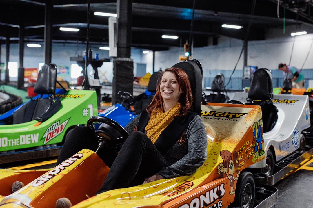 Woman smiling on indoor go-karts