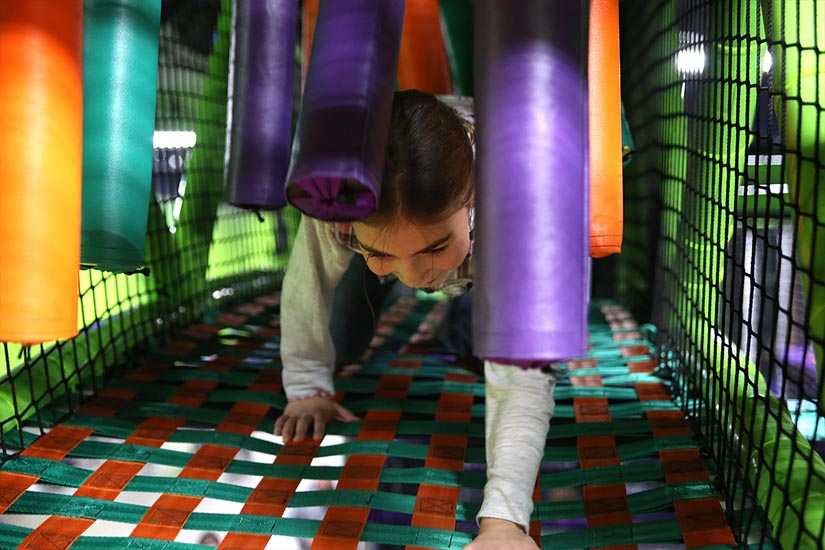 Girl climbing in indoor playground