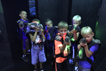 bunch of boys holding laser tag guns