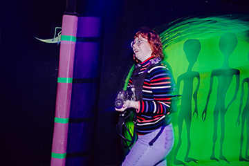 Woman playing laser tag