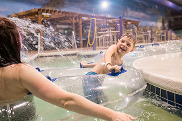 boy laughing on lazy river