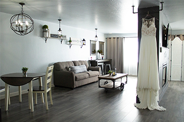 Magnolia suite's sitting area featuring a sofa, table and chairs, and double sided fireplace