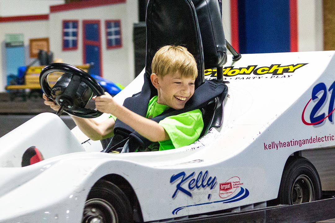 Boy driving white go-kart