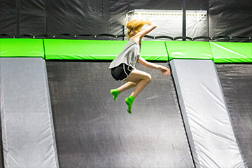 Girl jumping high in the air.