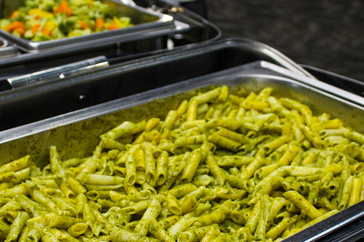 Penne pasta with creamy pesto sauce.