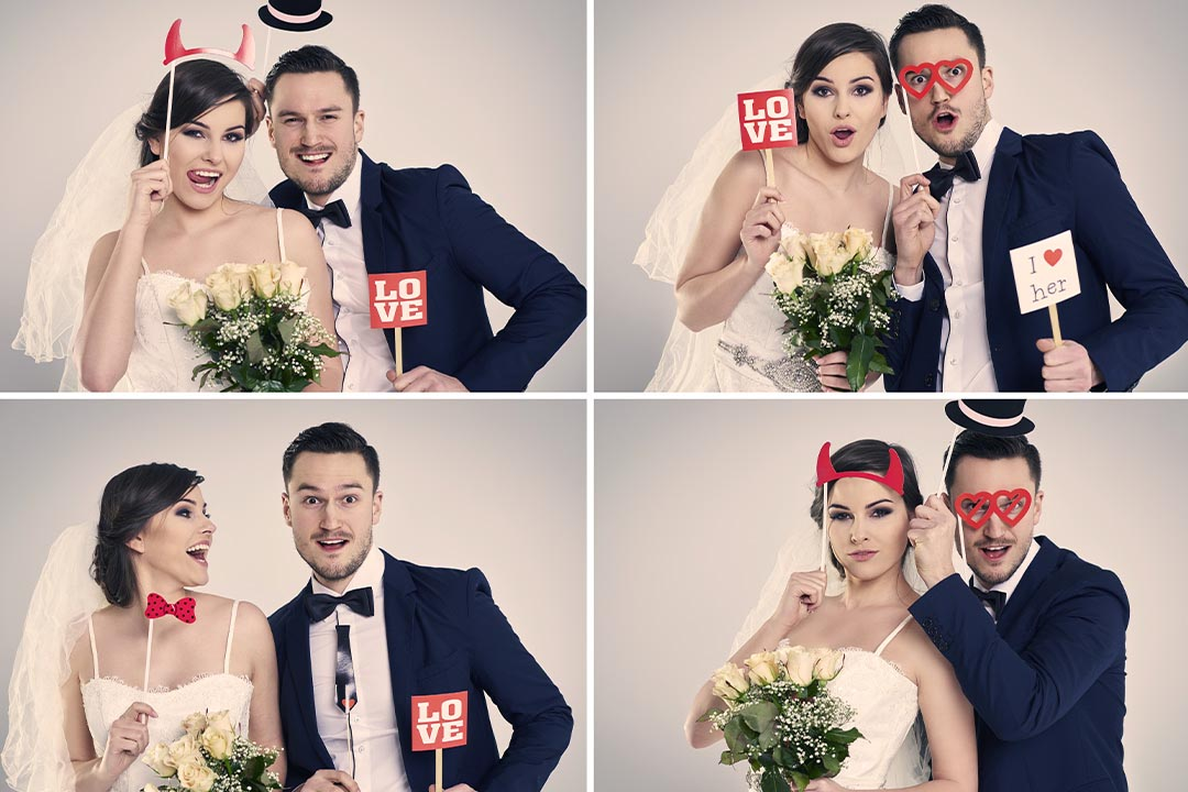 Couple taking silly photos in photobooth