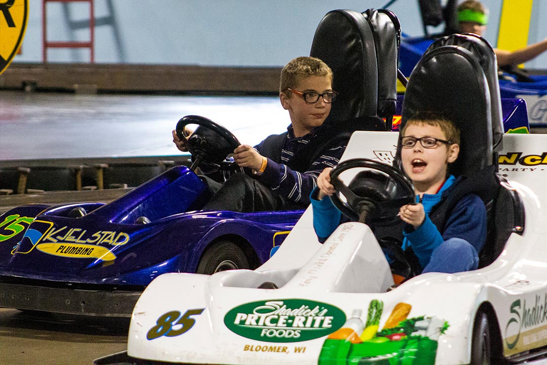 Kids driving go-karts
