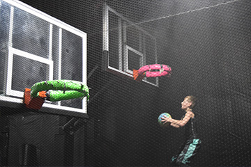 Kid dunking a basketball