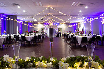 Metropolis Banquet hall reception style with string lights draped from the ceiling