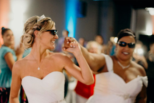 Two Beautiful brides with sunglasses smiling photo by Breeanna Kay