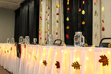 Fall decor at head table in Metropolis Banquet Hall
